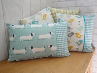 aqua dachshund with bird cushion on blanket box 2
