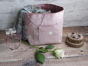 Pink velvet basket angled shot with scarf and jewellery and rose